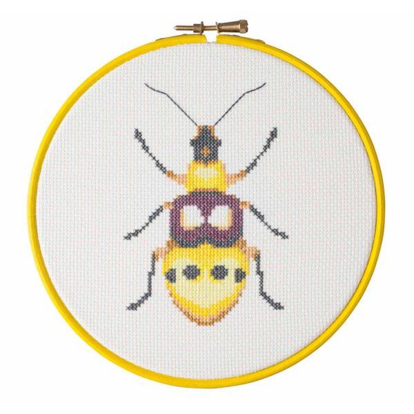 Stickmuster gelber Käfer bzw. Insekt