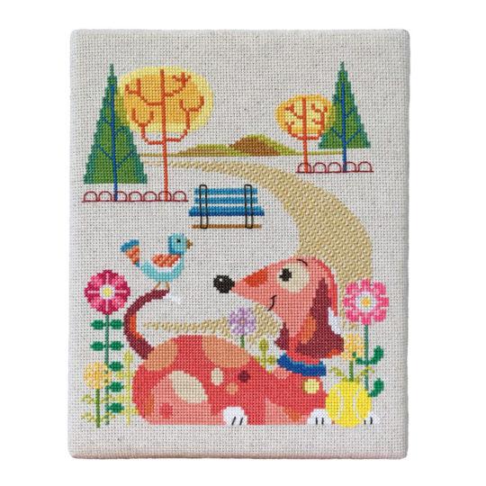 Stickbild Hund im Park für Kreuzstich