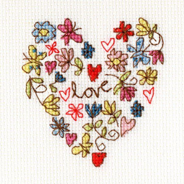 Grußkarte mit Herz aus vielen kleinen Motiven im Kreuzstich sticken | über Zur Lila Pampelmuse